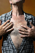 male person toughing his breast hair