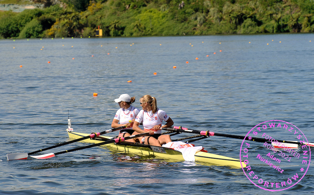 (BOW) MAGDALENA FULARCZYK & (STROKE) JULIA MICHALSKA (BOTH POLAND) WITH MEDALS AND POLISH FLAG ON THEIR BOAT AFTER IN WOMEN'S DOUBLE SCULLS FINAL A DURING REGATTA WORLD ROWING CHAMPIONSHIPS ON KARAPIRO LAKE IN NEW ZEALAND...NEW ZEALAND , KARAPIRO , NOVEMBER 07, 2010..( PHOTO BY ADAM NURKIEWICZ / MEDIASPORT )..PICTURE ALSO AVAIBLE IN RAW OR TIFF FORMAT ON SPECIAL REQUEST.