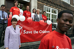Save the Children volunteers celebrate national volunteers week with Harriet Harman (in lilac suit), July 6, 2000..Photo by Andrew Parsons / i-Images..