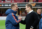 Brentford manager Dean Smith greeting Milton Keynes Dons manager Karl Robinson during the Sky Bet Championship match between Brentford and Milton Keynes Dons at Griffin Park, London, England on 5 December 2015. Photo by Matthew Redman.