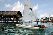 World Sailing Emerging Nations Program - Boca Chica Sailing Club, Santo Domingo 08/19/2017 - DAY 1- Pupil arranges his boat rudder before practice