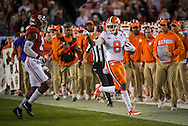 #8 Deon Cain points at an Alabama defender as he runs out of bounds,