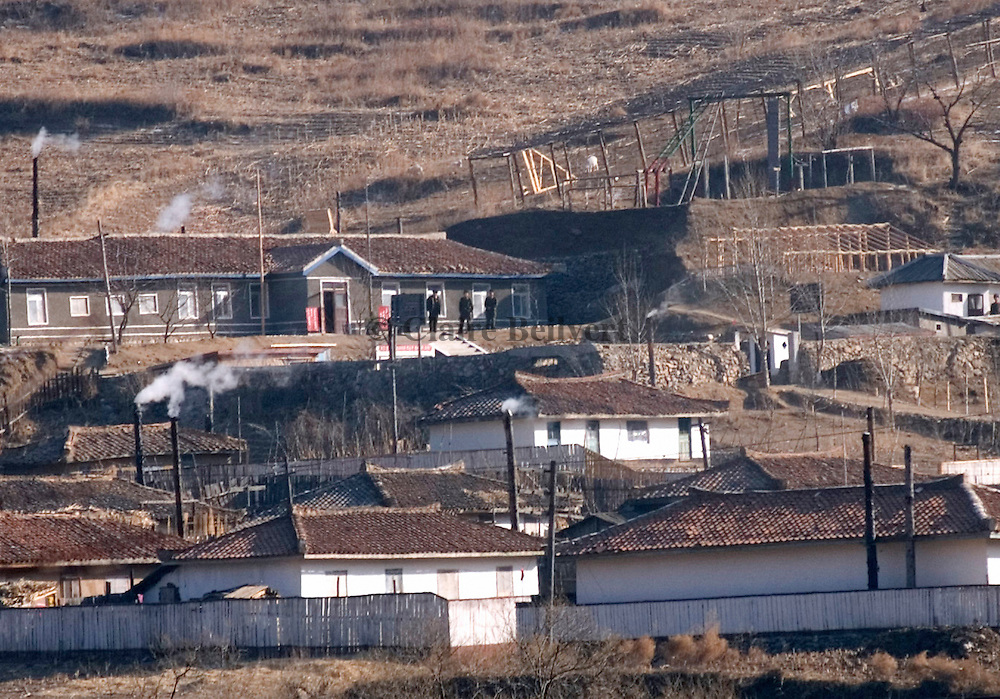 North korean village near the border with China. Military people are watching to border. They have the right to shoot whoever tries to cross the river to escape to China