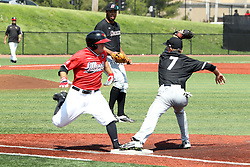 17 April 2016:  Joe Kelch arrives at 1st base while running out a bunt but is a toe too late as Connor Kopach gets the put out throw in time during an NCAA Division I Baseball game between the Southern Illinois Salukis and the Illinois State Redbirds in Duffy Bass Field, Normal IL