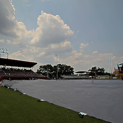 June 04, 2011; Tallahassee, FL, USA; The tarp is rolled out in preparation of severe weather in the area suspending play in the eighth inning of the Tallahassee regional of the 2011 NCAA baseball tournament with UCF Knights leading the Bethune-Cookman Wildcats 14-5 at Dick Howser Stadium. Mandatory Credit: Derick E. Hingle