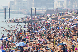 © Licensed to London News Pictures. 24/08/2019. Brighton, UK. Thousands of people take to the beach in Brighton and Hove on the August Bank Holiday Saturday as hot and sunny weather is hitting the seaside resort. Photo credit: Hugo Michiels/LNP