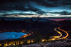 """""""Donner Lake Sunset 39""""- Long exposure photograph of Donner Lake at sunset. The traffic from Hwy 80 can be seen winding through the mountains."""