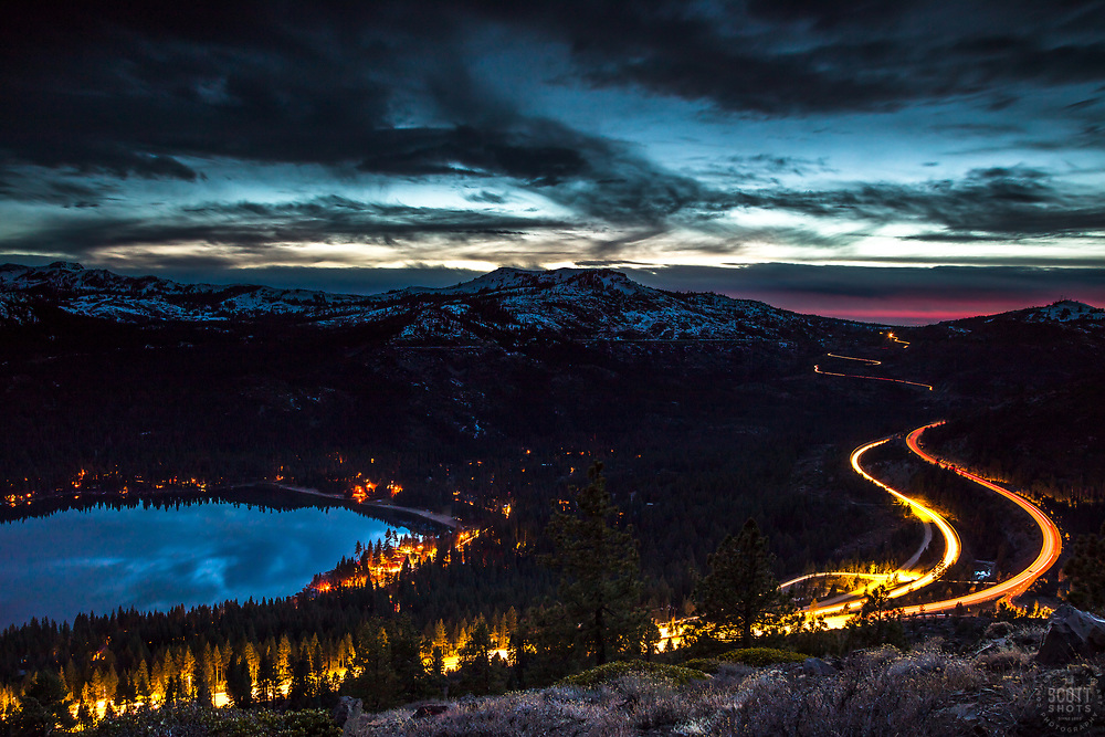 """Donner Lake Sunset 39""- Long exposure photograph of Donner Lake at sunset. The traffic from Hwy 80 can be seen winding through the mountains."