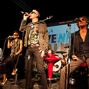 Alabama 3 on stage. An event billed as 'We need to talk about Fracking was held at the Rollerdisco venue to raise awareness about fracking. Fracking is a highly controversial method of extracting gas underground. The line-up included Alabama 3 and the Asian Dub Foundation and DJs Gavin Turk and Mark Stewart and Pandit G.
