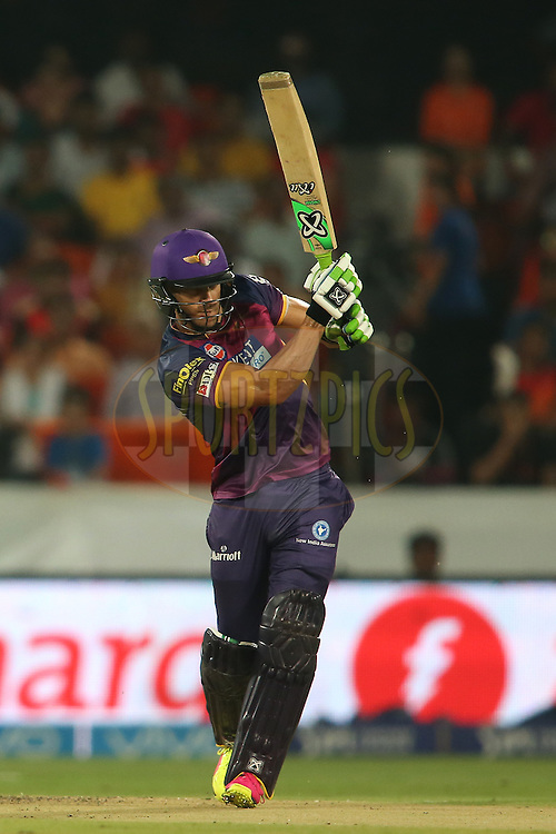 Faf du Plesis of Rising Pune Supergiants drives a delivery down the ground during match 22 of the Vivo IPL 2016 (Indian Premier League) between the Sunrisers Hyderabad and the Rising Pune Supergiants held at the Rajiv Gandhi Intl. Cricket Stadium, Hyderabad on the 26th April 2016<br /> <br /> Photo by Shaun Roy / IPL/ SPORTZPICS