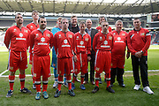 MK Dons manager Karl Robinson with representatives of MK Dons 20 disabled football teams during the Sky Bet Championship match between Milton Keynes Dons and Brentford at stadium:mk, Milton Keynes, England on 23 April 2016. Photo by Dennis Goodwin.