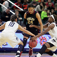 Ashley's Felicity Havens is has the ball stolen by Millbrook's Destinie Dun, left and Jaylann Dillard during the championship game of the Leon Brogden Holiday Basketball Tournamnet. (Jason A. Frizzelle)