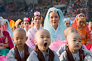 The annual Lotus Lantern Festival is held to celebrate Buddha's Birthday. Opening ceremony for the parade at Dongdaemun Stadium. Little monks yawning.