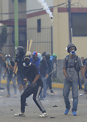 June 1, 2017 - Valencia, Carabobo, Venezuela - They throw stones to be dispersed with gases and plastic pellets, when protesting at the gates of the National Electoral Council, CNE, against the constituent, as illegal. Protestants call for the resignation of President Nicolas Maduro. In Valencia, Carabobo state. Photo: Juan Carlos Hernandez (Credit Image: © Juan Carlos Hernandez via ZUMA Wire)
