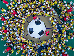 June 20, 2017 - Changxing, China -  Children play a game with footballs during a football festival at the Central Kindergarten in Changxing County, east China's Zhejiang Province.  (Credit Image: © Xu Yu/Xinhua via ZUMA Wire)