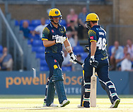 Glamorgan's Craig Meschede celebrates a boundary with team-mate Chris Cooke<br /> <br /> Photographer Simon King/Replay Images<br /> <br /> Vitality Blast T20 - Round 8 - Glamorgan v Gloucestershire - Friday 3rd August 2018 - Sophia Gardens - Cardiff<br /> <br /> World Copyright © Replay Images . All rights reserved. info@replayimages.co.uk - http://replayimages.co.uk