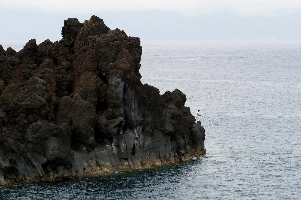 Fisherman on a rock, Pico, Azores, Portugal