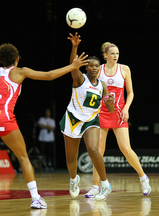 South Africa's Thuli Qegu passes the ball against England in the New World Quad series netball match, Claudelands Arena, Hamilton, New Zealand, Thursday, November 01, 2012. Credit:SNPA / Dianne Manson.