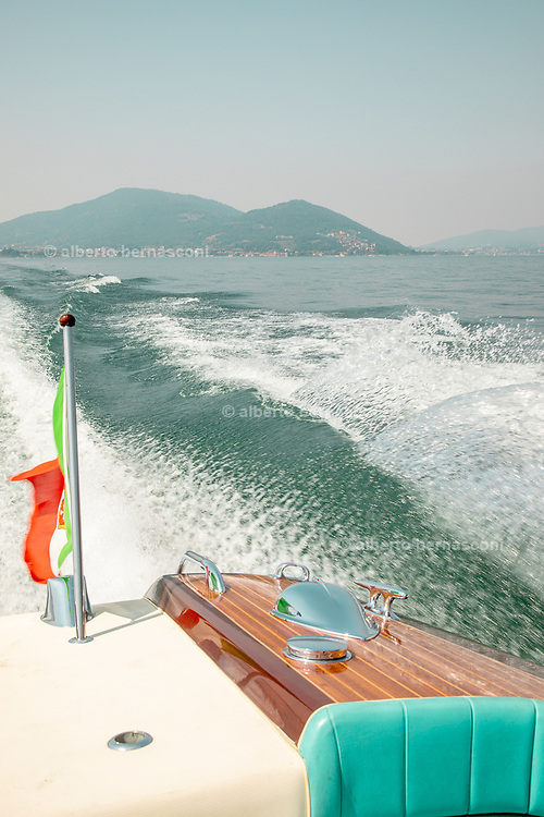 iTALY, ISEO LAKE, Romano Bellini driving a special model of  Acquarama Riva, there are still two in the world