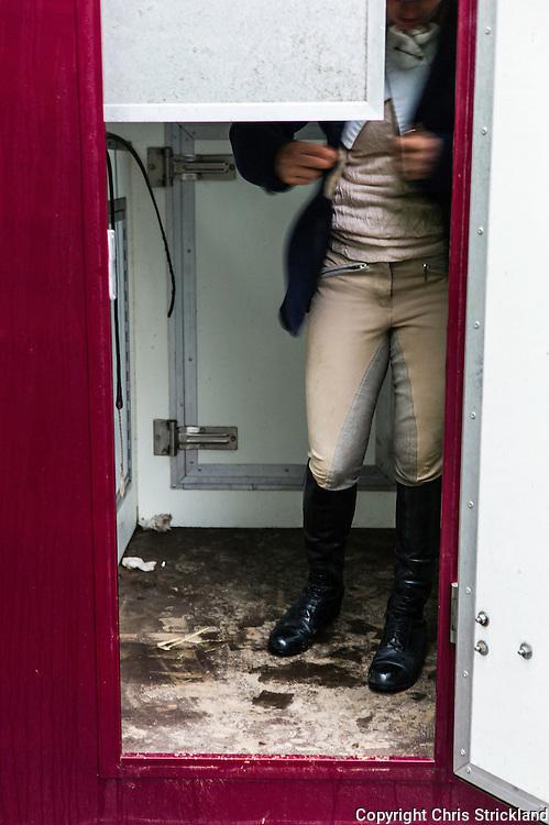 Jedburgh, Scottish Borders, UK. 12th December 2015. Four Star eventer Emily Galbraith gets ready for a days hunting on horseback in the back of a horsebox.