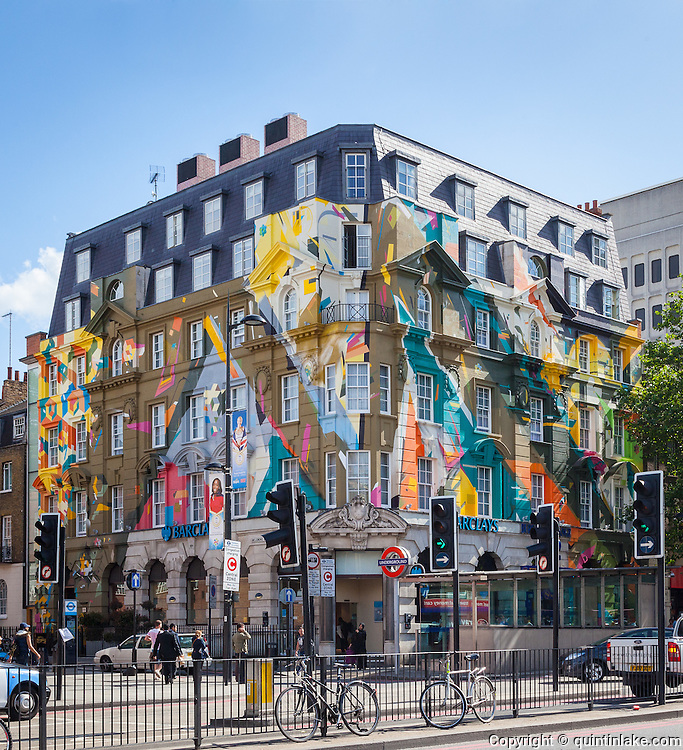 """Marmite"" a graffiti mural painted on the classical facade of Megaro Hotel opposite St Pancras station, London, 2012. The mural was designed and painted by four members of street art collective, Agents of Change."