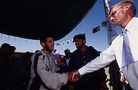 AFGHANISTAN.Kabul, 23 August 2005.Disability National Games, torch run from Darul Aman to Ghazi Stadium..Troy W. Greisen Senior Vice President of Special Olympics International and a participating athlete are exchanging greetings during the Turch Run Opening in Darul Aman