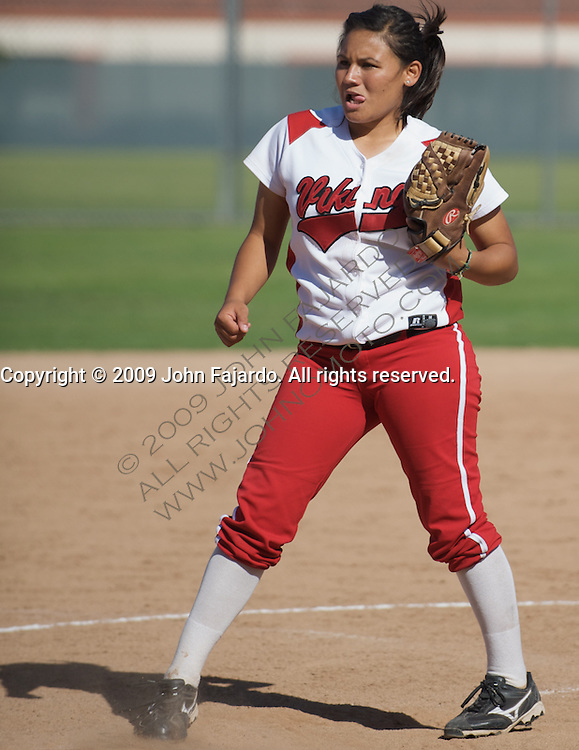 Christine Gonzalez pitches a strike for LBCC in the game against El Camino College at the LBCC Softball Field on April 7, 2009.