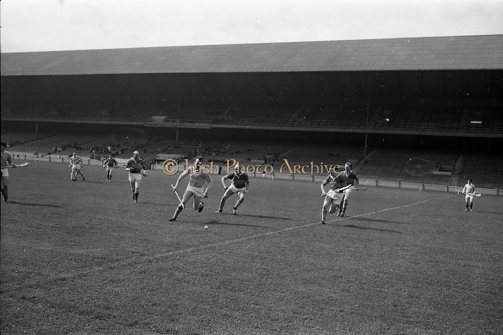 02/04/1967<br /> 04/02/1967<br /> 2 April 1967<br /> National Hurling League Semi-Final: Antrim v Kerry at Croke Park, Dublin.<br /> Kerry full-back, N. Sheely (second from the left), and Antrim half-back, P. McShane (left), racing for the ball.
