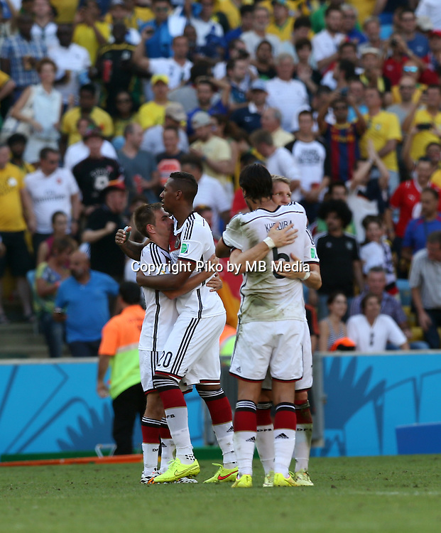 Fifa Soccer World Cup - Brazil 2014 - <br /> FRANCE (FRA) Vs. GERMANY (GER) - Quarter-finals - Estadio do Maracana Rio De Janeiro -- Brazil (BRA) - 04 July 2014 <br /> Here German team celebrating the victory. End of the match 0-1. German players Philipp LAHM (L), Bastian SCHWEINSTEIGER (C), Sami KHEDIRA (C) and Jerome BOATENG (R)<br /> &copy; PikoPress