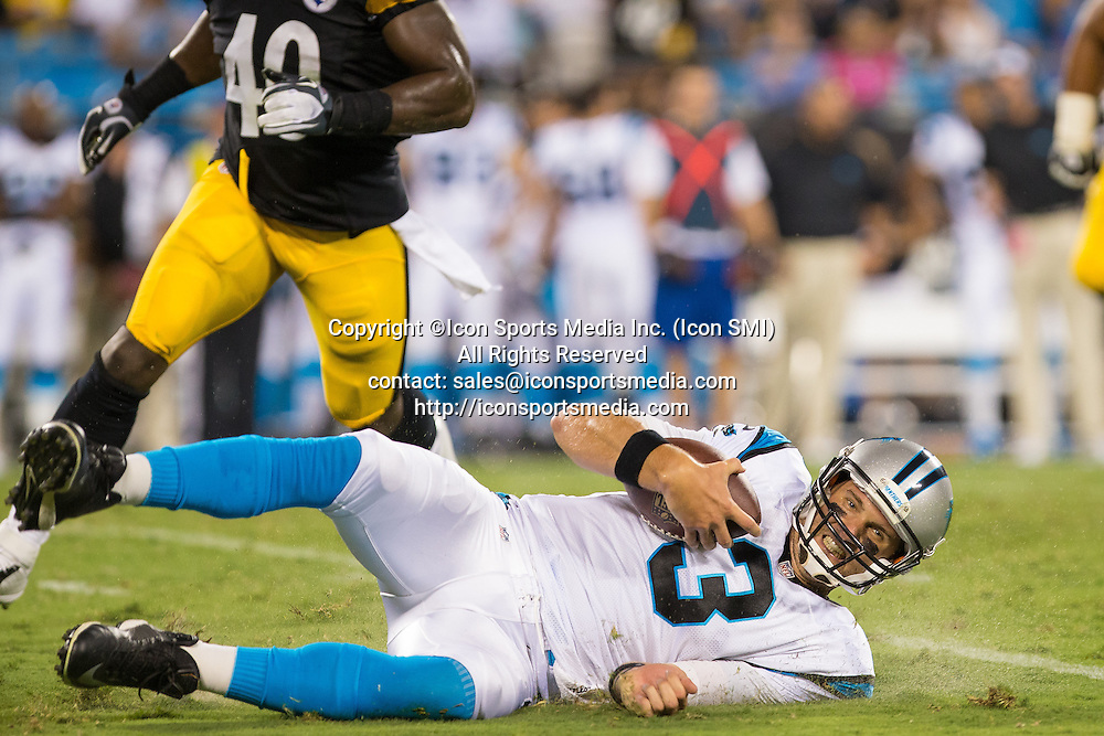 29 August 2013: Carolina Panthers quarterback Derek Anderson (3) slides after a QB scramble during the preason football game between the Carolina Panthers and the Pittsburgh Steelers  at Bank of America Stadium in Charlotte, NC.