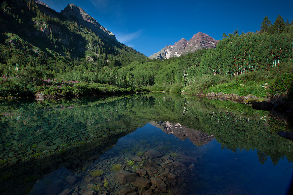 Maroon Bells reflected in a small lake near Aspen, Colorado in the Snowmass Wilderness