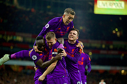 LONDON, ENGLAND - Saturday, November 3, 2018: Liverpool's captain James Milner celebrates scoring the first goal with team-mate during the FA Premier League match between Arsenal FC and Liverpool FC at Emirates Stadium. Sadio Mane, Roberto Firmino, Andy Robertson. (Pic by David Rawcliffe/Propaganda)
