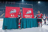 KELOWNA, CANADA - SEPTEMBER 20: Colten Martin #8 and Tyson Baillie #24 of Kelowna Rockets stands beside the BC Division Championship and Regular Season Championship banners as the Kelowna Rockets raise it during the home opener against the Kamloops Blazers on September 20, 2014 at Prospera Place in Kelowna, British Columbia, Canada.   (Photo by Marissa Baecker/Shoot the Breeze)  *** Local Caption *** Colten Martin; Tyson Baillie;