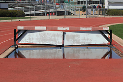 11 April 2015: Pit on track is full of water from recent rains  during an NCAA Division III mens lacrosse match between the Elmhurst Bluejays and the Illinois Wesleyan Titans in Bloomington IL