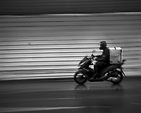 Motorcycle in the Rain. Afternoon walkabout in Lisbon. Image taken with a Leica CL camera and 23 mm f/2 lens.