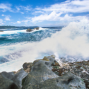 Inside the protective barrier of the islands and coral reefs there was a beautiful tranquil lagoon. Beyond the tranquillity the Indian Ocean was still hurling waves and creating explosions of spray. I wanted to investigate the biggest breaks on a huge outcrop of bare rock on the outer side of the islands. I clambered up on to the rock and watched the massive swells that had travelled thousands of miles across some of the most tempestuous seas on the planet colliding with a boulder the size of a house. It was an awesome spectacle of the power of the ocean. I took some dramatic photographs but wanted to capture the perfectly timed moment of maximum impact. I dashed out onto the rock to a position that I thought was out of reach of the waves and quickly retreated to avoid the spray. They seemed to be consistently hitting a maximum height but all of a sudden a monster wave crept in unnoticed from a slightly different angle and hit me from the side. I spun around to face it and was engulfed in a surging mass of energised water; it felt like being hit by a car! I was swept off my feet and desperately tried to arrest my slide towards the foaming cauldron below, and to protect my camera. I just managed to save myself from what could have been a desperate plight if I had been swept into the sea. I felt pain, and the first thing that I noticed was that my arm was badly scraped; then I could see that I was standing in a pool of blood. I lifted my foot up and winced at the sight of a huge gash; it was very painful and I couldn't stand on it. The infected sores on my shins and feet were still causing me some discomfort, especially at night. I wasn't looking forward to going to bed that night because I wasn't expecting to be able to find any comfortable positions. When I hobbled back to camp I cleaned and dried my camera and lens, but that camera body and my essential wide-angle zoom lens were now out of commission.