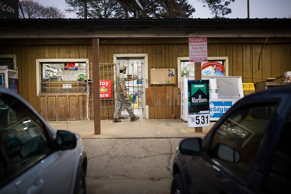 Michael Ramos, 33, whose call sign is Delta12 and is a member of Georgia Security Force III%, makes a trip to a local convenience store for a pack of cigarettes following a day of training on private property near Jackson, Ga., on Saturday, April 1, 2017. Photo by Kevin D. Liles for BuzzFeed<br /> <br /> <br /> Shot during a FTX (field training exercises) weekend for Georgia Security Force III% militia, as well as some members for the South Carolina Security Force III%. GSF III% is part of the umbrella group, III% Security Force, which includes groups from several states. Chris Hill (Blood Agent), commanding officer of GSF III%, is the founder of the Security Force movement. According to him, GSF III% membership fluctuates between 30-50 members and growing by about one member per day.  GSF III%, as do the other groups, train one weekend per month.