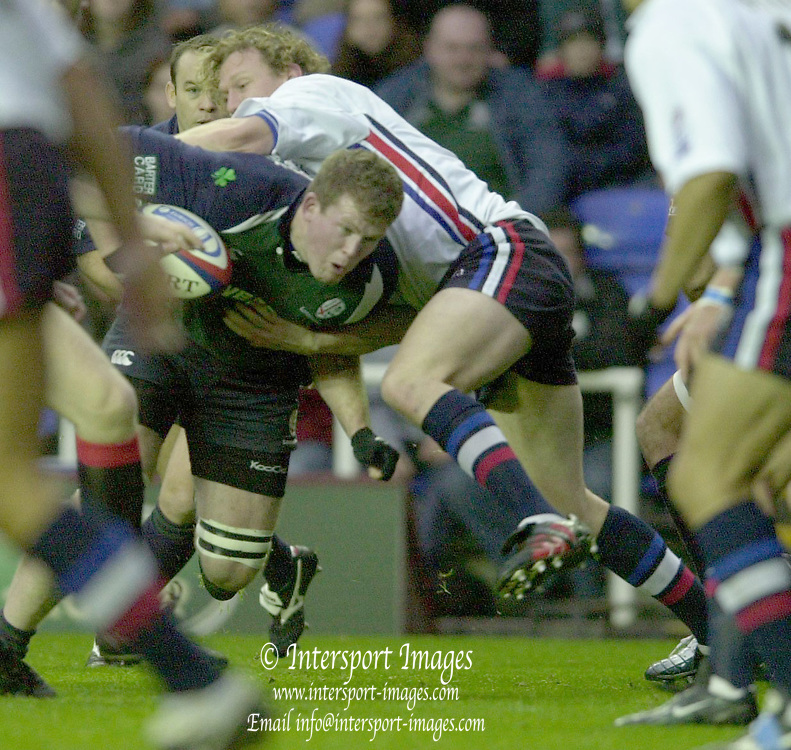 © Peter Spurrier/Intersport Images .Tel + 441494783165 email images@Intersport-images.com.29/11/2003 - Photo  Peter Spurrier.2003/04 Zurich Premiership Rugby - London Irish v Sale Sharks.Exiles Phil Murphy ducks under the tackles of the Sharks defence..