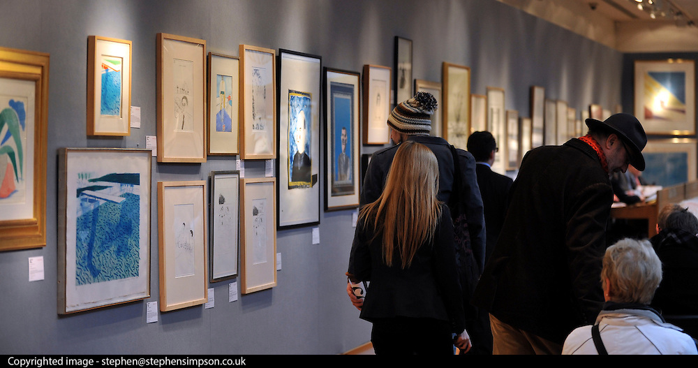 © Licensed to London News Pictures. 17/02/2012, London, UK. The auction attracted a large audience. An auction of items by British artist David Hockney takes place at Christie's in London's South Kensington today, 17th February 2012. It features over 100 works by Hockney, including etchings, lithographs, drawings and photography. They are expected to sell for over £1m. The sale spans over 40 years of Hockney's career. Photo credit : Stephen Simpson/LNP