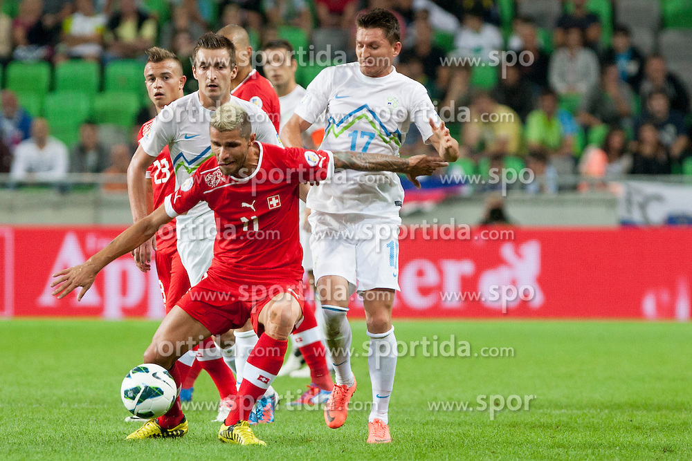 Valon Behrami of Sweitterland and Andraz Kirm of Slovenia during qualifications football match for world cup 2014 in Brazil between national team of Slovenia and Switzerland, on September 7, 2012 in Ljubljana, Slovenia. (Photo by Urban Urbanc / Sportida.com)