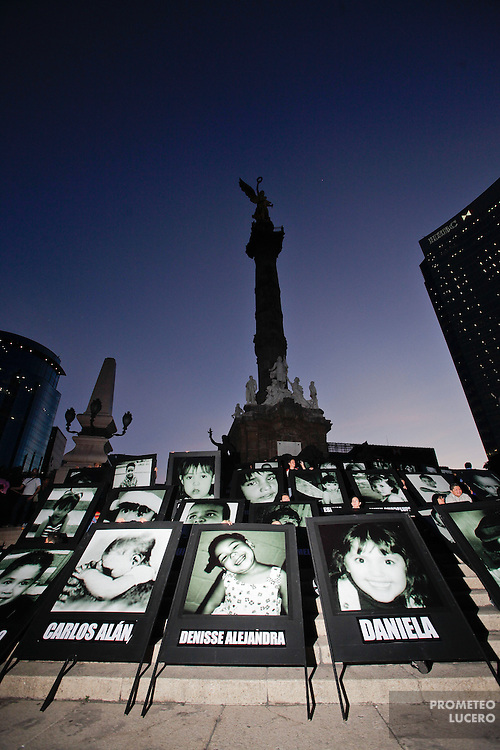 MEXICO CITY.- Parents of the 49 children dead after the fire in the ABC Daycare in 2009, walked through Mexico City streets into the Monumento de la Independencia carrying big portraits and blue and pink flags.<br /> <br /> On june 5th, 2009, the ABC Daycare in Hermosillo, northern state of Sonora, burned after a a fire in a neighbor warehouse.  49 children died and other 41 got hospitalized. The center passed its security requirements and showed, since then, the conditions of the surrogated daycare installations along the country. (Photo: Prometeo Lucero)