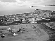 The view from a plane bound for Japan, as it takes off over the airport in Tumon, Guam, on Sunday, Mar. 11, 2007.  Sometimes known as 'America in Asia', Guam is a popular destination for Japanese tourists ( accounting for approx 90% of the island's visitors) with average visitor numbers from Japan approaching 1million.  The island, a 3.5 hour flight from Japan, has more than 20 large hotels and numerous duty-free shopping malls catering to the Japanese tourists predilection for designer brand name goods, as well as golfing and other water based entertainment features. In 2007-2008 US military personal currently stationed in the Japanese Okinawan Islands will relocate their bases and operations  to Guam, helping to stabilise the island's economy which suffered after tourism decreased in recent years due to a  fear of flying by Japanese post 9-11 World Trade Centre disaster, a 2003 typhoon and the SARS disease outbreak in Asia.