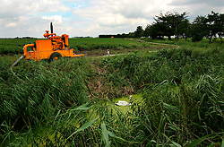 UK ENGLAND CAMBRIDGESHIRE ELY 7AUG06 - Diesel pump and piping next to a drainage canal surrounding agricultural land in the Fenlands, Cambridgeshire...jre/Photo by Jiri Rezac..© Jiri Rezac 2006..Contact: +44 (0) 7050 110 417.Mobile:  +44 (0) 7801 337 683.Office:  +44 (0) 20 8968 9635..Email:   jiri@jirirezac.com.Web:    www.jirirezac.com..© All images Jiri Rezac 2006 - All rights reserved.