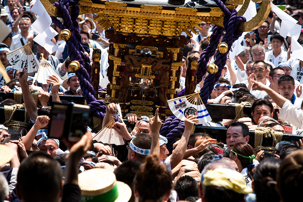 TOKYO, JAPAN - MAY 20: The residents of Asakusa band together to carry a 'mikoshi' (portable shrines) while they chant together during the Sanja Festival in front of in Senso-ji Temple in Asakusa, Tokyo on May 20, 2017. These mikoshi is carried in the streets of Asakusa to bring luck, blessings and prosperity to the area and its inhabitants. (Photo: Richard Atrero de Guzman/NUR Photo)