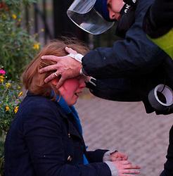 © under license to London News Pictures. 9/12/2010. A young woman is helped by a police medic. On the day that MPs vote on tuition fees, 1000s demonstrated in London against a proposed rise in fees and cuts in support.