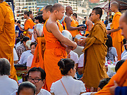 23 NOVEMBER 2014 - BANGKOK, THAILAND: Buddhist monks walk through the crowd at a mass alms giving ceremony in Bangkok Sunday. 10,000 Buddhist monks participated in the ceremony on Rajadamri Road in front of Central World shopping mall. The alms giving was to assist Buddhist temples in the insurgency wracked southern provinces of Thailand, where Buddhist monks on their alms rounds have been targeted by Muslim extremists. The ceremony was sponsored by Wat Phra Dhammakaya, the center of the Dhammakaya Movement, a Buddhist sect founded in the 1970s. The temple has become active in Thai politics.    PHOTO BY JACK KURTZ