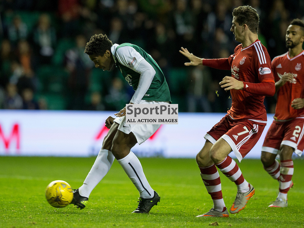 Hibernian FC v Aberdeen FC<br /> <br /> Dom Malonga (Hibernian) scores Hibs second goal during the Scottish League Cup clash between Hibernian and Aberdeen FC at Easter Road Stadium on 23 September 2015.<br /> <br /> Picture Alan Rennie.