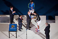 Novak Djokovic (SRB) accepts the Championship Trophy. 2012 Australian Open Tennis Championship. Mens Singles Singles. Final. Rod Laver Arena, Melbourne and Olympic Parks, Melbourne, Victoria, Australia. 29/01/2012. Photo By Lucas Wroe