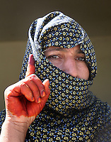 """Mother-of-six Nazuko, 45, from Lashkar Gah, said: """"Under Karzai's government, I lost my son and my husband but I still voted for him. I want him to help us."""""""