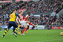 Stoke's Peter Crouch scores the opening goal of the game. - Photo mandatory by-line: Dougie Allward/JMP - Mobile: 07966 386802 - 06/12/2014 - SPORT - Football - Stoke - Britannia Stadium - Stoke City v Arsenal - Barclays Premie League